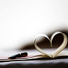 sarcastic_ink: A book with the pages splayed in the shape of a heart. (book: heart)