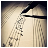 musyc: Fountain pen and sheet music being written (Stock: Writing music)