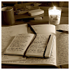 musyc: Open handwritten journal by lit candle (Stock: Journals)