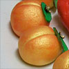 redsixwing: Photo of faux-gilded marzipan peaches. (golden peaches of immortality)