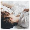 blush: girl asleep in a rumpled bed (stock - asleep)
