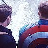 "melonbutterfly: Icon of Steve Rogers & Bucky Barnes; we see their backs as they stare into the icy ravine that will be Bucky's ""death"" (Arthur)"