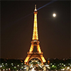 icecream_kitty: a photo of the Eiffel Tower lit up at night, with a full moon in the background (la tour Eiffel) (Default)
