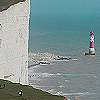 muccamukk: White chalk cliffs in forground, small light tower rising out of the sea in background. (Lights: Dover)