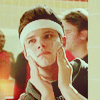 laceblade: Kurt from Glee, wearing sweatband, applying moisturizer to cheeks. (Glee: Kurt moisturizer)