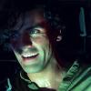 gloss: man grinning devilishly (SW: Poe grin)