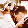 muccamukk: Phryne putting Jack's tie back on, both leaning in close. (MFMM: Tied to You)