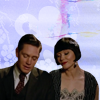 muccamukk: Jack and Phryne sitting at a piano, leaning close and singing together. (MFMM: Duet)