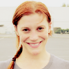 ghanimaa: Katee Sackhoff grinning, her hair in a braid. (katee sackhoff grinning red hair braid)