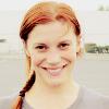 ghanimaa: Katee Sackhoff grinning, her hair in a braid. (katee sackhoff grinning red hair braid)