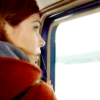 lepos: (red coat looking out the window)