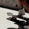 skatefree_diehard: image of a person riding a skateboard (Default)