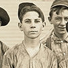 mervinmcginty: Young glass worker in Indiana, pale shirt, middle part in his hair, firm expression (Mervin(young))