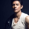 citizendamian: Joseph Marco, standing with a dark jacket on one shoulder in harsh lighting (Damian(nope))