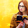 bluegansey: amy pond holding a book with a yellow background (amy pond yellow)