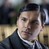 mervinmcginty: Adam Beach in a grey suit coat, white shirt, tie, hair neatly parted, looks down left and perturbed (Mervin(formal))