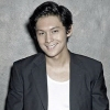 citizendamian: Joseph Marco in a suit coat and loose white shirt grinning (Damian(smiling))
