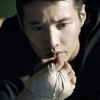 avian_cat: Won Bin with a crude bandage on his hand.  Hand is near chin, and expression worried. (Tom(beenbetter))