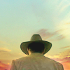 ninamalfoy: Raylan Givens with hat from behind against a light sundawn/sunset (latter days)