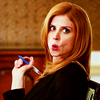 ninamalfoy: Donna turning her head and looking straight at you, lips pursed with wide eyes, sassy posture (suits:awesome!donna)