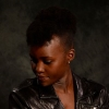 citizenmoore: Lupita Nyong'o looking down left in a leather jacket (Yvette(down))