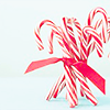 fleete: A cluster of candy canes held together with a red ribbon against a light blue background. (Candycanes)