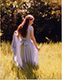 ext_137: Artsy photograph of me in a field wearing a blue dress. (Senior Portrait)