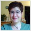 anjelabug: Close-up of me; I'm wearing a green shirt and a circular pendant. (face, me: face) (Default)