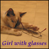 katherine: Girl with glasses: Fuzzy cat with a folded pair of glasses by her paw. (glasses)
