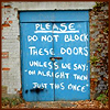"klgaffney: A door painted with text: PLEASE do not block these doors. Unless we say: ""oh alright then just this once."" (more what you'd call ""guidelines""...)"