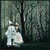 klgaffney: Detail from Henri Rousseau's Carnival Evening, depicting a male/female couple in clown costume in a dark forest. (carnival evening)