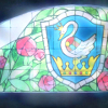 rynet_ii: Stained glass window depicting a shield with a swan and a crown, surrounded by roses. (a story in plain sight)