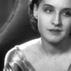 rydra_wong: Norma Shearer looking sideways, with a velvet dressing gown nearly slipping off one shoulder. (norma -- side)