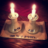 kass: two lit Shabbat candles (candles)