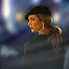 muccamukk: Sara in a beret and a lot of diamonds glancing back over her shoulder. (LoT: Undercover)