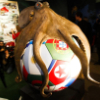 eightlazylegs: A sculpture of a brown octopus on a soccer ball (Soccer)