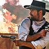 apollymi: Vasquez firing two guns, flames behind him, no text (Mag7**Vasquez: Fire)