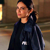 monanotlisa: Maggie Sawyer in her blue Police jacket looking up and serious, hair pulled back in a ponytail (maggie serious - supergirl)