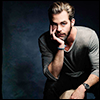 highlander_ii: Chris Pine sitting on an apple box, chin in hand, in front of a dark blue backdrop ([ChrisP] dk blue photoshoot)