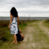take_the_good: Girl with guitar standing barefoot on dirt road watching storm clouds roll in. (Default)