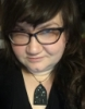 missjanette: me, glasses, hair down, curiology reindeer and night sky necklace. (Default)