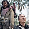 sharpest_asp: Baze standing behind Chirrut, looking down at him as Chirrut looks up (Star Wars: Baze and Chirrut)