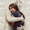 jenna_marianne: woman being hugged by anthropomorphized text (books:in love with books)