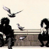 grassangel: Dream and Death from Sandman, sitting on some steps surrounded by pigeons (this is my angst icon, black&white, snark, yeah...)