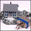 xtina: A mini house with a combo lock and chain. (security)