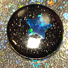 azurelunatic: A glittery black pin badge with a blue holographic star in the middle. (light pink)