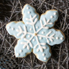 kiki_eng: an iced cookie in the shape of a snowflake (snowflake)