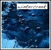wintercreek: Blue-tinted creek in winter with snowy banks. ([Glee] come on get happy)