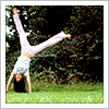 wintercreek: Woman doing a cartwheel in the g ([misc] the joy of being young in spring)