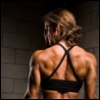 cyprinella: A woman with strong musculature from the back (swole)